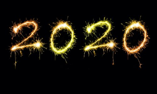 New years 2020 sparkling sign with golden orange digits floating isolated against black background